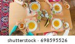 children eat at the table soup...   Shutterstock . vector #698595526
