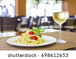 italian shrimp pasta with wine... | Shutterstock . vector #698612653