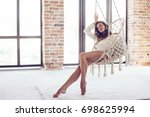 young woman chilling at home in ... | Shutterstock . vector #698625994