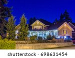 luxury house at night in... | Shutterstock . vector #698631454