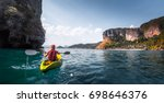 woman paddles kayak in the calm ... | Shutterstock . vector #698646376