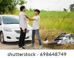 two men are fighting about car... | Shutterstock . vector #698648749