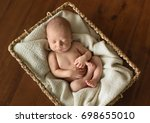 newborn baby sleeping in a... | Shutterstock . vector #698655010