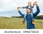 spending family time together.... | Shutterstock . vector #698673610