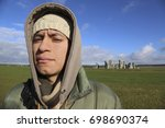 tourist young man on stonehenge | Shutterstock . vector #698690374