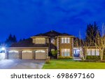 luxury house at night in... | Shutterstock . vector #698697160