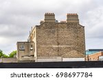 house with brick wall gable and ... | Shutterstock . vector #698697784