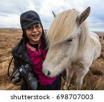 photographer with icelandic... | Shutterstock . vector #698707003