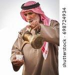 bedouin old man offers arabic... | Shutterstock . vector #698724934
