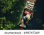 seller on boat   floating... | Shutterstock . vector #698747269
