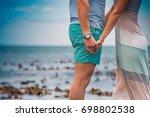 happy summer couple hold hands... | Shutterstock . vector #698802538