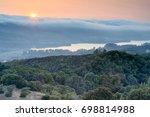 fog slides over the hills in a...   Shutterstock . vector #698814988