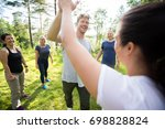 man and woman giving high five... | Shutterstock . vector #698828824
