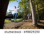 friends watching woman crossing ... | Shutterstock . vector #698829250