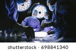 team of surgeons performing... | Shutterstock . vector #698841340
