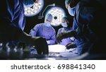team of surgeons performing... | Shutterstock . vector #698841340