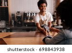 young woman paying by credit... | Shutterstock . vector #698843938