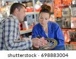man buys brake wheel in auto... | Shutterstock . vector #698883004