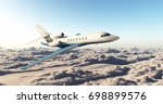 business jet over the clouds... | Shutterstock . vector #698899576
