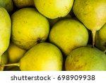 green pears in a wicker basket | Shutterstock . vector #698909938