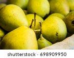 green pears in a wicker basket | Shutterstock . vector #698909950