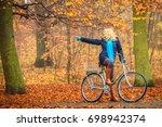 active woman riding bike... | Shutterstock . vector #698942374