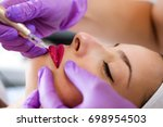 young woman applying permanent...   Shutterstock . vector #698954503