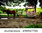 a horse with a coach | Shutterstock . vector #698967700