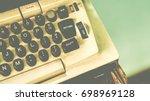old green antique typewriter... | Shutterstock . vector #698969128