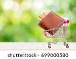 brown old wallet and gold... | Shutterstock . vector #699000580