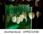 chimes hanging in the window ... | Shutterstock . vector #699021448