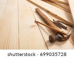 hammer and nails on wooden... | Shutterstock . vector #699035728