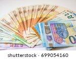 euro cash. many euro banknotes... | Shutterstock . vector #699054160