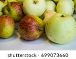 fresh harvest of apples in a... | Shutterstock . vector #699073660