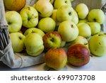fresh harvest of apples in a... | Shutterstock . vector #699073708