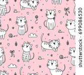 Stock vector seamless pattern with cute cats 699086530