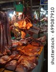 Small photo of Fresh meat and offal in the butcher shop in the old market of Siem Reap, Cambodia