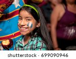 girl with painted face  eating... | Shutterstock . vector #699090946