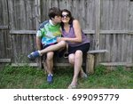 mother being kissed by son with ... | Shutterstock . vector #699095779