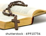 Rosary with holy bible over white background - stock photo