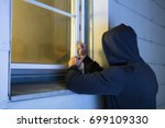 close up of robber in hood... | Shutterstock . vector #699109330