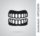 isolated denture icon symbol on ... | Shutterstock .eps vector #699126934