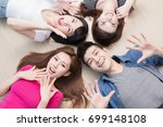 young people smile happily and... | Shutterstock . vector #699148108