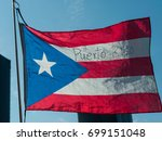 flag of puerto rico against the ... | Shutterstock . vector #699151048