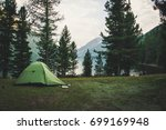 a green tent in the woods in...   Shutterstock . vector #699169948