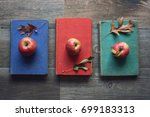 apples on vintage books with... | Shutterstock . vector #699183313