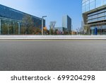 empty road and modern office... | Shutterstock . vector #699204298