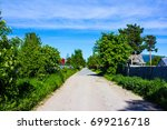 country road  blue sky and... | Shutterstock . vector #699216718