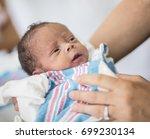 beautiful happy newborn baby...   Shutterstock . vector #699230134