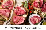raw beef meat on a dark wooden... | Shutterstock . vector #699253180